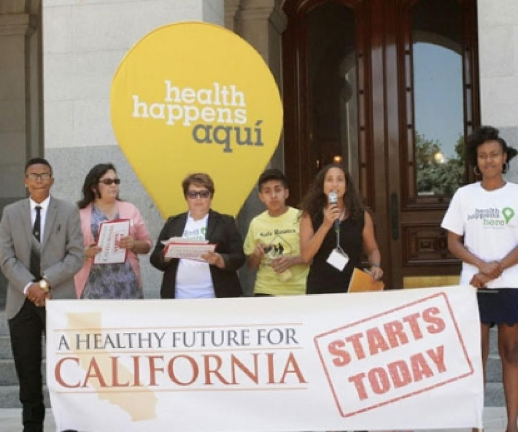 "Rally leaders with a sign that says ""A Healthy Future for California"""