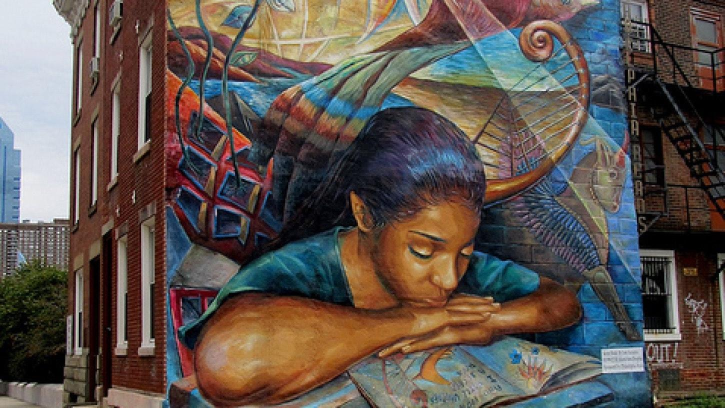 Mural of a girl reading